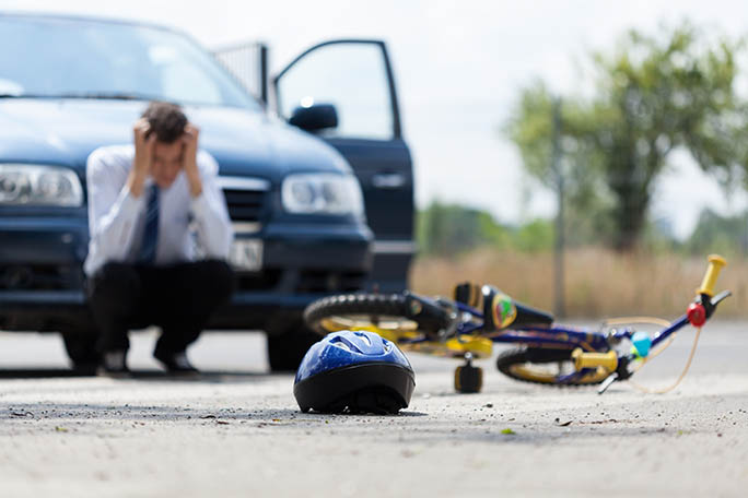 Sad driver after collision with bicycle, horizontal